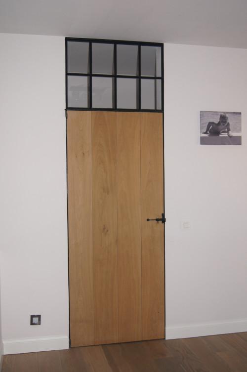 Massief eiken deur in smeedijzer frame met bovenlicht